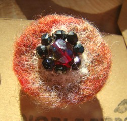 Needle felted pin  in shades of russet and cream with an embellishment of beading £5 plus pp.