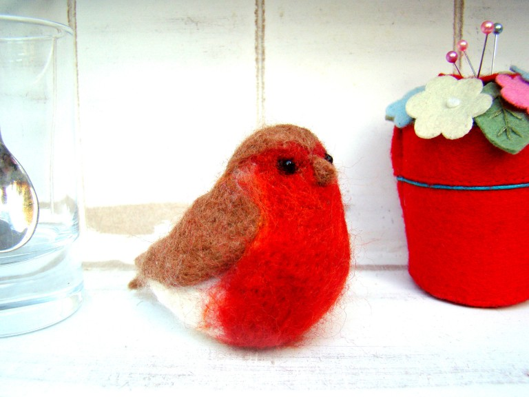 Cute, handmade needle felted Robin made in 100% Merino wool with black seed beaded eyes.  He sits approximately 6 cm tall and is 4.5 cm at his widest and measures 9 cm beak to tail, he nestles nicely in the palm of your hand. He's waiting for you in our shop now!